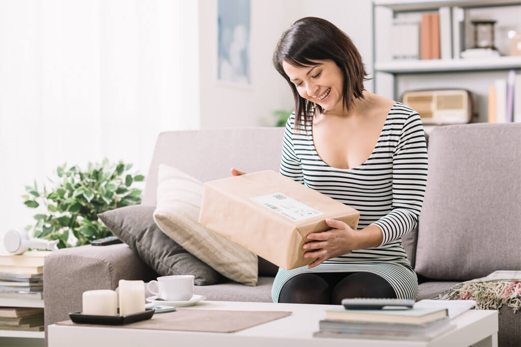 woman at home receiving mail package